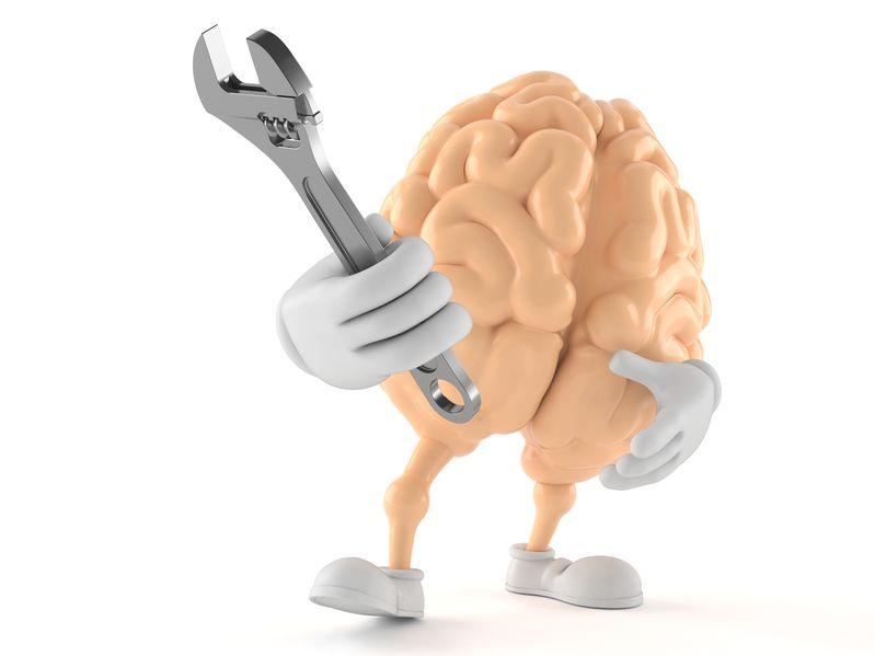 Caricatura de un cerebro con una llave inglesa en la mano, para señalar que la mente y los pensamientos son herramientas que se pueden controlar y usar a nuestro favor.